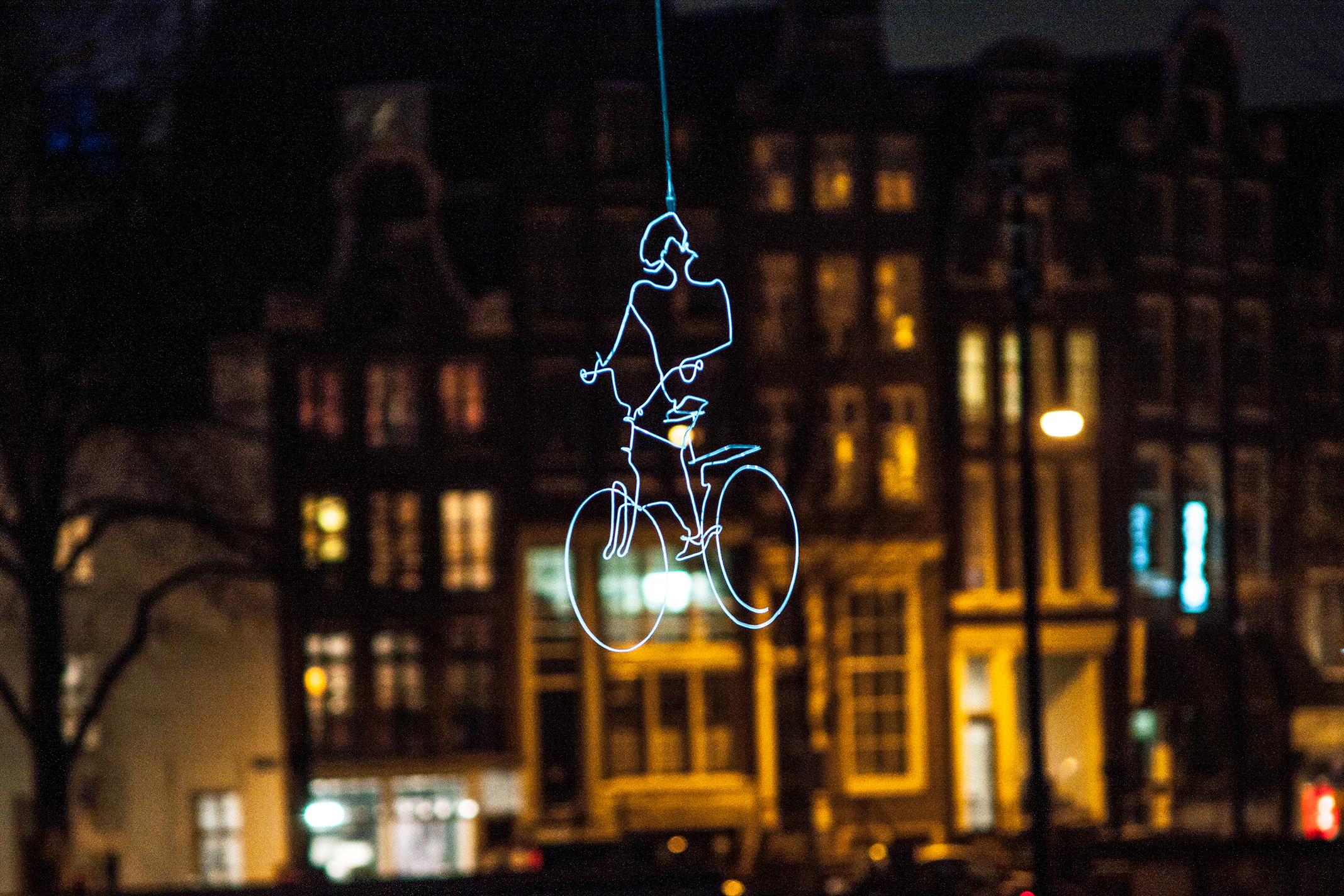 Drawn in Light, a light art installation by Ralf Westerhof, suspendend over Amsterdam canal