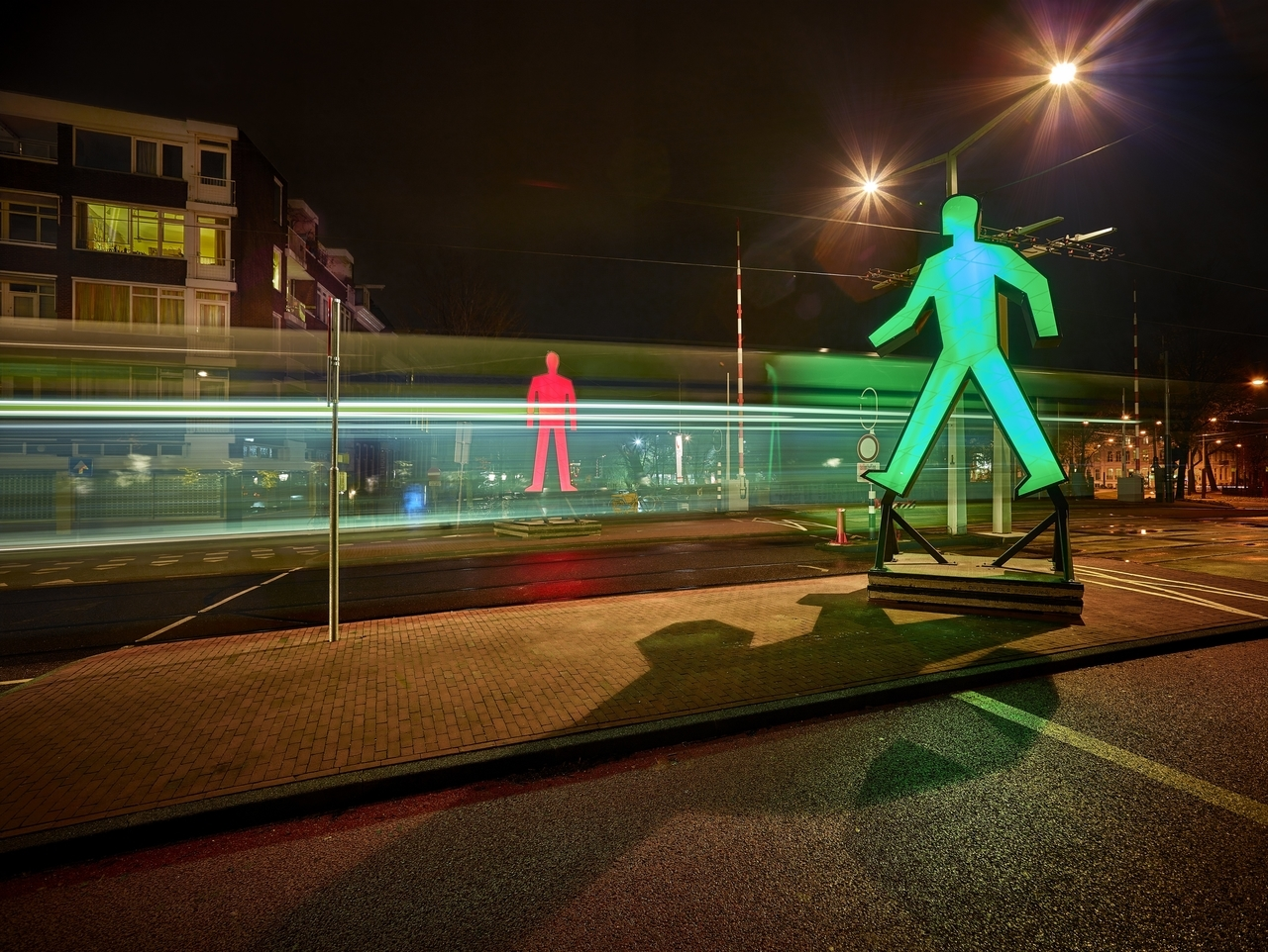 Strangers in the Light sculptures by Victor Engbers & Ina Smits represent pedestrian crossing lights