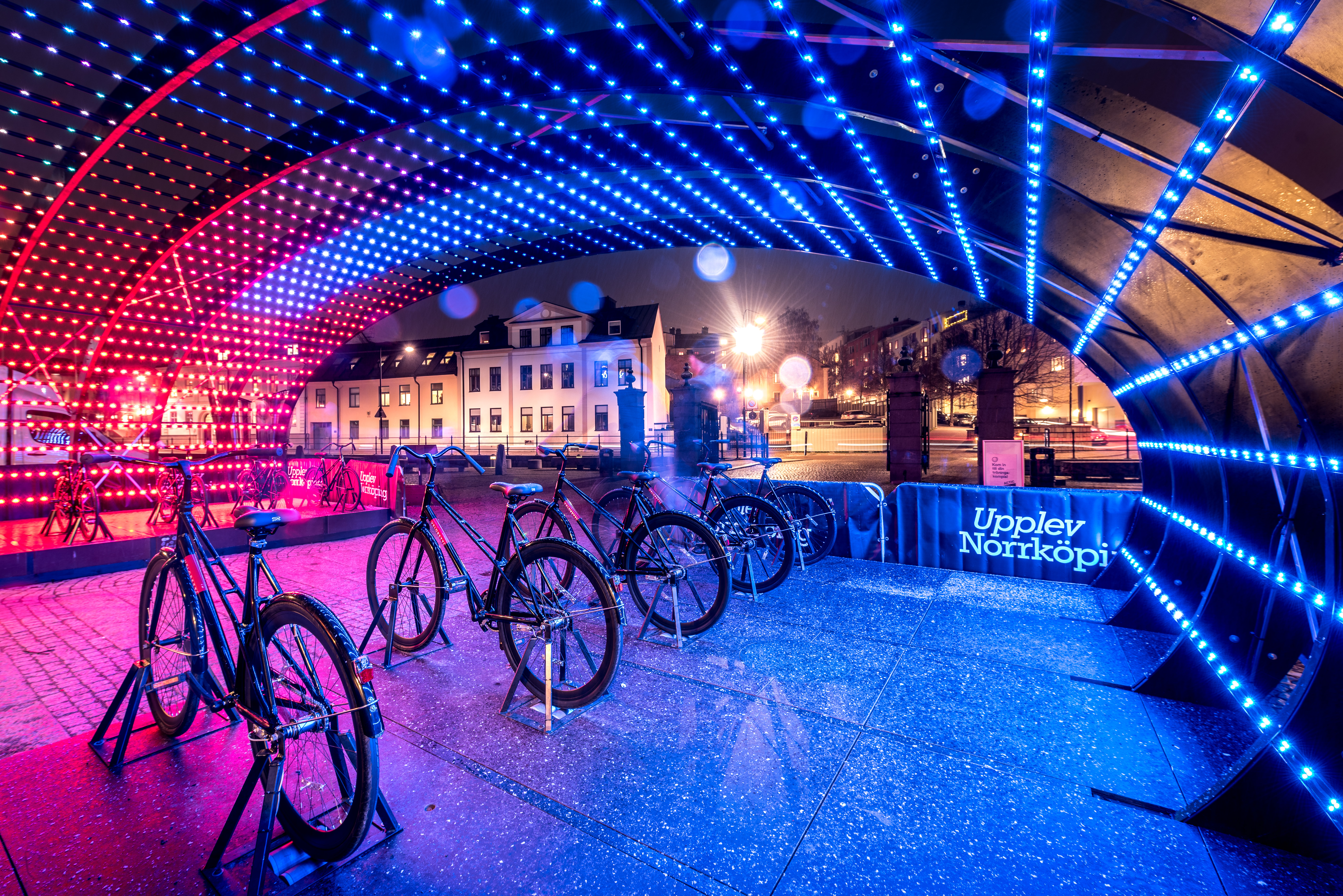 Contesters pushing pedals on the Lightbattle installation by VENIVIDIMULTIPLEX during Amsterdam Light Festival
