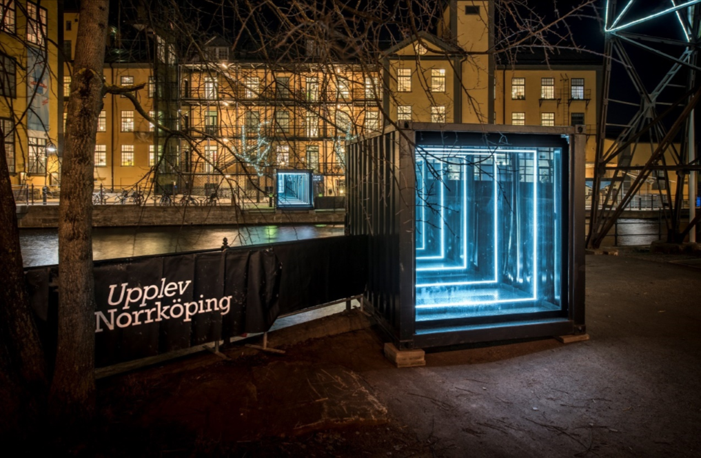 Bridge by Tomas Ribas is a virtual bridge of light over a canal at Amsterdam Light Festival